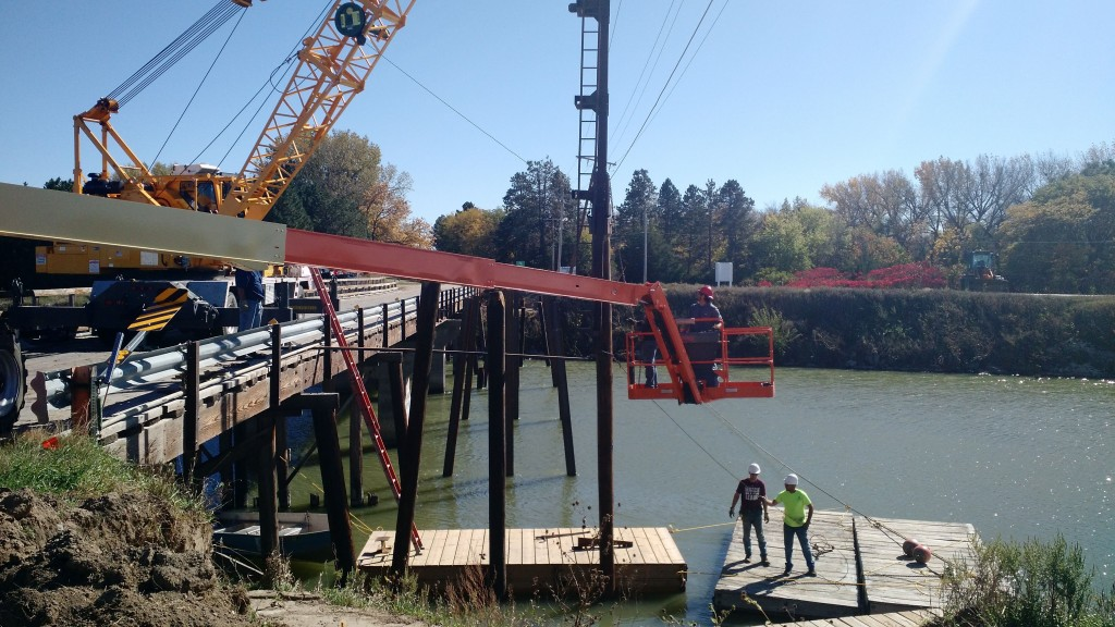 Central personnel finish driving the last steel piling for the pedestrian bridge.