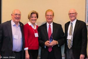 Former State Senator Tom Carlson (second from right) received the Kremer Award at the NSIA/NWRA Annual Convention.  Shown with Sen. Carlson (left to right) are Jim Goeke, selection committee member; Groundwater Foundation Executive Director Jane Griffin; and Don Kraus, selection committee member.