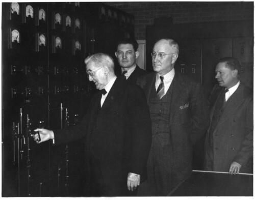 Senator George Norris pulls the controls to bring Jeffrey Hydroplant online for the first time on Jan. 5, 1941